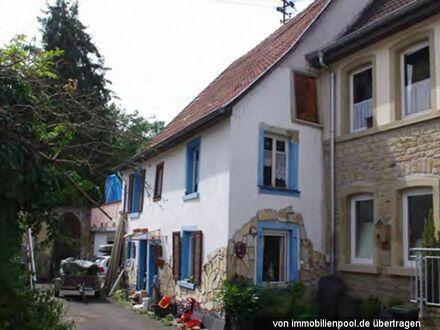 Einfamilienhaus und Nebengebäude (Zwangsversteigerung)