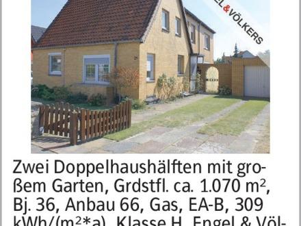 Zwei Doppelhaushälften mit gro- ßem Garten, Grdstfl. ca. 1.070 m², Bj....