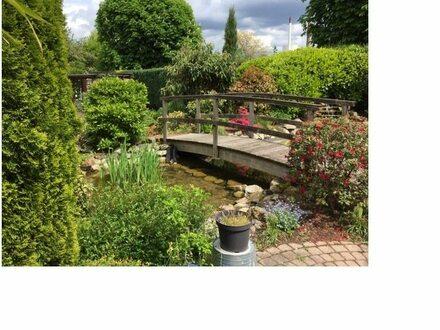Ein Haus mit vielen Nutzungsmöglichkeiten und einem Traumgarten!