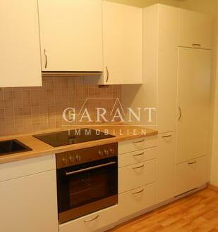 Schöne 2 Zimmer-Wohnung mit Wintergarten und Garagen-Box