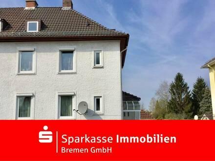 Großes renovierungsbedürftiges Reihenendhaus mit Garten und Garagen in Bremen-Kattenturm