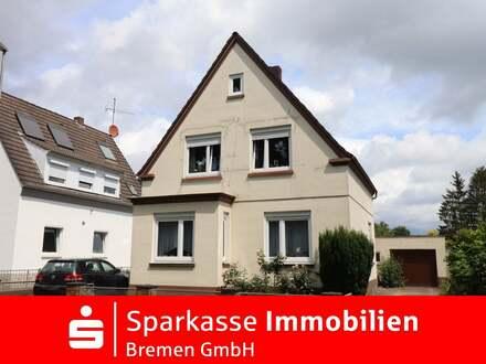 Ein - Zweifamilienhaus mit klassischem Charme, großem Garten und Garage in Hammersbeck