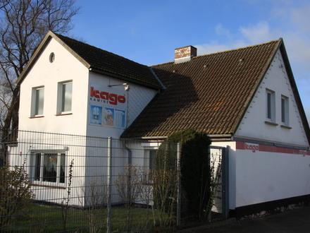 Wohn- und Geschäftshaus mit Ausstellungs- und Verkaufsräumen in werbewirksamer Lage (Renditeobjekt oder Eigennutzung)