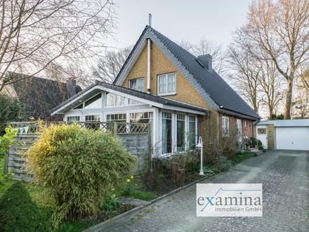 Solides Einfamilienhaus mit Wintergarten auf schön eingefriedetem Grundstück. Optimal für Familien!