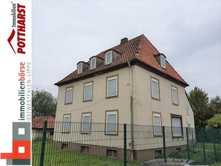 Sanierungsbedürftiges 2-Familienhaus mit ausgebautem Dachgeschoss