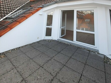 Attraktive Dachgeschosswohnung mit Feldblick in Citylauflage von Bad Soden!