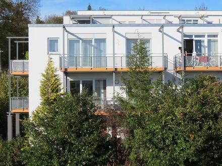 REMAX - Maisonettewohnung am Eselsberg, EG mit Balkon, Garten und Tiefgarage