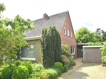 Geräumige Doppelhaushäfte mit Garage in Logabirum