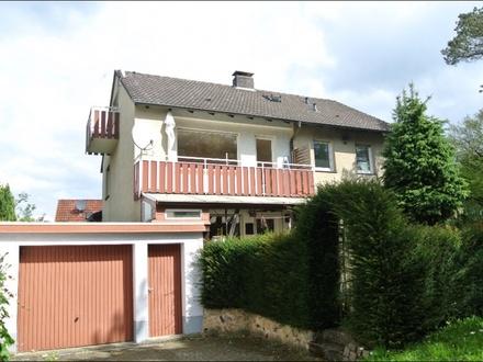 Hausansicht Balkon- und Gartenseite