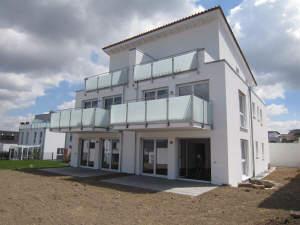 Traumhafte Neubauwohnung mit Terrasse und Gartenanteil in stadtnaher Lage