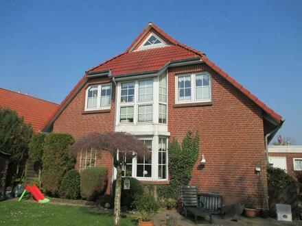 Große Eigentumswohnung/Reihenendhaus mit Grundstück in ruhiger Lage von Norden