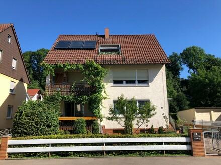 Erdgeschosswohnung mit 2 Balkonen und Gartenanteil