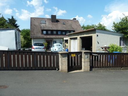 2 Fam. Wohnhaus mit Nebengebäude und 3 Garagen