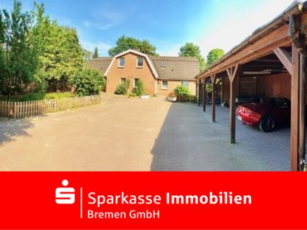 Traumhafte Obergeschoss Wohnung in einer Doppelhaushälfte mit tollem Grundstück in Worpswede
