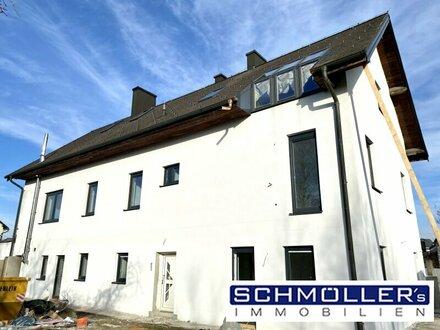 Erstbezug! Helle 2-Zimmer-Wohnung mit Terrasse und Garten am Mühlbach