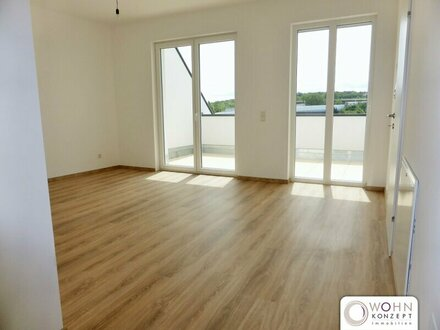 Erstbezug: klimatisierte 63m² DG-Wohnung + 10m² Terrasse!