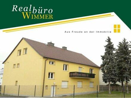 Großzügige 4-Zimmer-Wohnung mit Garten und Balkon