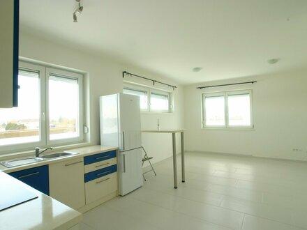 Moderne Wohnung mit Terrasse in Ruhelage. Sehr niedrige Betriebskosten!