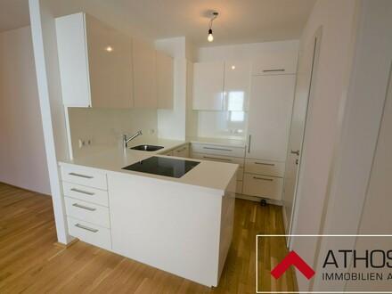 Neuwertige, helle 3-Zimmer-Wohnung mit Balkon und TG-Platz in ruhiger Lage