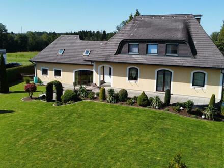 Exklusives Einfamilienhaus mit großem Grundstück