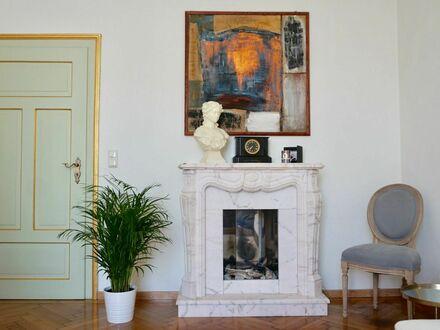 Romantische 2-Zi. Wohnung in Schwabing mit offenem Kamin und Gartenteich | Romantic flat in Schwabing with open fireplace…