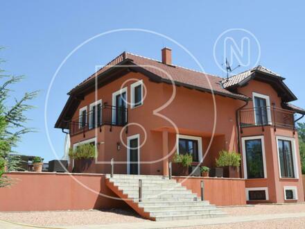 Modernes Einfamilienhaus auf großem Grund in Grünruhelage!