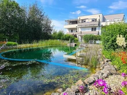 Hochwertige Gartenwohnung mit idyllischem Schwimmteich