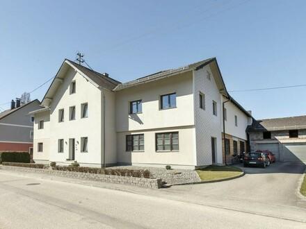 Mehrparteienhaus mit 4 Einheiten und Lagerflächen in Bruckmühl