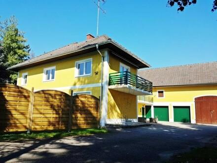 Exklusive Wohnung in einem repräsentativen neu renovierten Landhaus mit Eigengarten!