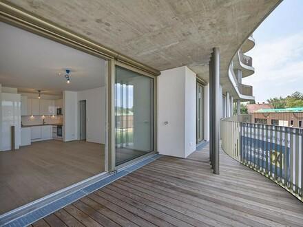 FILMREIFER ERSTBEZUG - mit 25 m² Balkon, Designküche und TG- Stellplatz