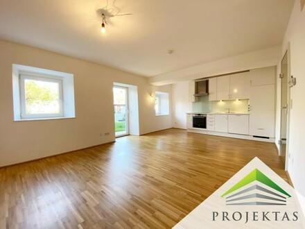 Hochwertig renovierte 2 Zimmerwohnung mit Küche & Privatgarten in Thening zu mieten