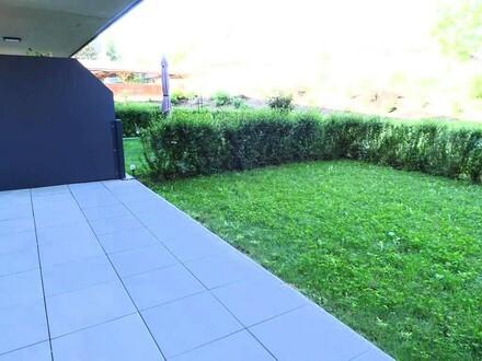 Neuwertige, offene Mietwohnung mit Terrasse, Eigengarten sowie TG-Stellplatz