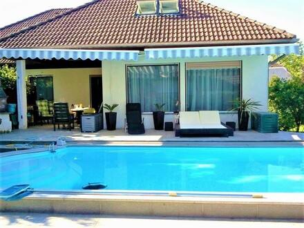 Großzügiges Einfamilienhaus in idyllischer Lage mit Pool!
