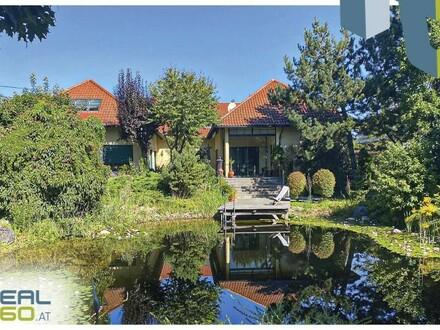 Exklusive Villa auf wunderbarem Grundstück mit altem Baumbestand, Schwimmteich und Indoorpool!