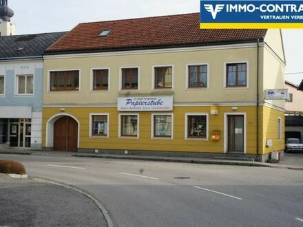 Verkaufs- und Bürohaus mit privater Wohnung