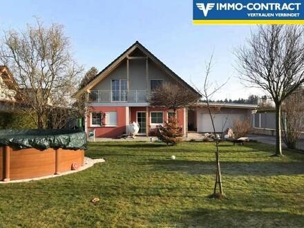 ELK Fertighaus mit Terrasse, Garten und Garage