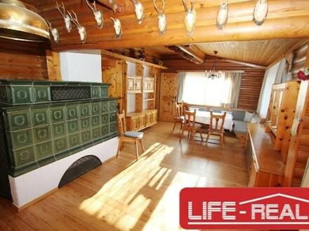 Blockhaus mit gemauertem Untergeschoss