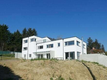 Belagsfertige Neubauwohnung mit Garten in sonniger Lage