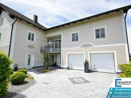 Außergewöhnliches und hochwertiges Wohnhaus mit exklusivem Dachgeschoßausbau, über 1000m²Grund und Einliegerwohnung in…